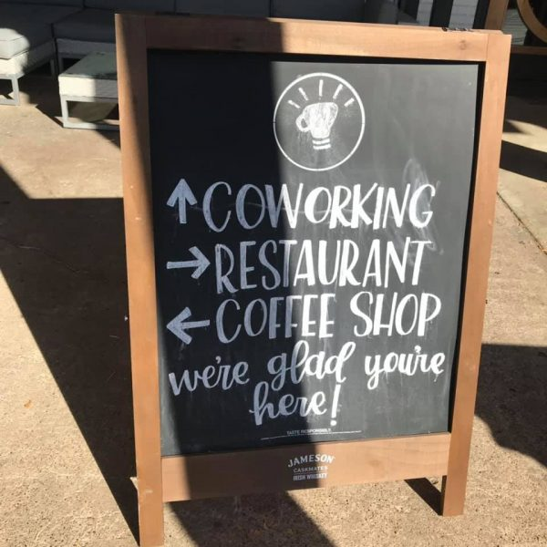 Communion Neighborhood Cooperative chalkboard: coworking, restaurant, and coffee shop. We're glad you're here! This is Richardson.